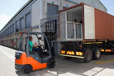 Forklift offloading a truck